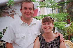 Portrait of couple smiling,