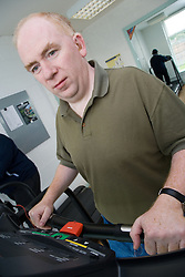 Portrait of man exercising at the gym,