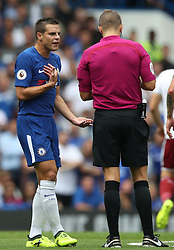 Chelsea's Cesar Azpilicueta (left) is booked for unsporting behaviour by referee Craig Pawson during the Premier League match at Stamford Bridge, London.