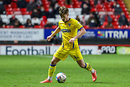 AFC Wimbledon midfielder Alex Woodyard (4) dribbling during the EFL Sky Bet League 1 match between Charlton Athletic and AFC Wimbledon at The Valley, London, England on 12 December 2020.
