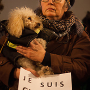 A woman with her poodle holds a signs stating 'Je suis Charlie' - I am Charlie. Londoners show their solidarity with the 12 people killed in an attack on the magazine Charlie Hebdo in Paris and their revulsion of the attack on freedom of speech at a vigil in Trafalgar Square. Three attackers killed ten journalist working for Charlie Hebdo and two police officers, the worst terrorist attack in Paris, France in 50 years.