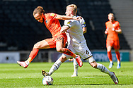 Portsmouth FC midfielder Marcus Harness (19) battles for possession with Milton Keynes Dons defender Harry Darling (6) during the EFL Sky Bet League 1 match between Milton Keynes Dons and Portsmouth at stadium:mk, Milton Keynes, England on 17 April 2021.
