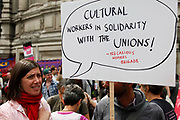 Cultural workers in solidarity with the unions. Precarious workers brigade. Demonstration in Central London on a day of General Strike action by public sector workers and unions. Civil servants, teachers, health workers all came out on a day of peaceful march and protest against government cuts which look set to see their pensions change.