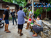 16 MAY 2017 - BANGKOK, THAILAND: Residents of Pom Mahakan gather in an empty lot in the old fort. The lot used to be a family home. The family was evicted by city officials in March, 2017 and the structure torn down. The final evictions of the remaining families in Pom Mahakan, a slum community in a 19th century fort in Bangkok, have started. City officials are moving the residents out of the fort. NGOs and historic preservation organizations protested the city's action but city officials did not relent and started evicting the remaining families in early March.           PHOTO BY JACK KURTZ