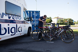 A Cervélo-Bigla Cycling Team mechanic checks the tyre pressures for one last time before the Crescent Vargarda - a 152 km road race, starting and finishing in Vargarda on August 13, 2017, in Vastra Gotaland, Sweden. (Photo by Balint Hamvas/Velofocus.com)