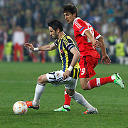 Fenerbahce's Gokhan Gonul (L) and Benfica's Rodrigo (R) during their UEFA Europa League Semi Final first match Fenerbahce between Benfica at Sukru Saracaoglu stadium in Istanbul Turkey on Thursday 25 April 2013. Photo by Aykut AKICI/TURKPIX