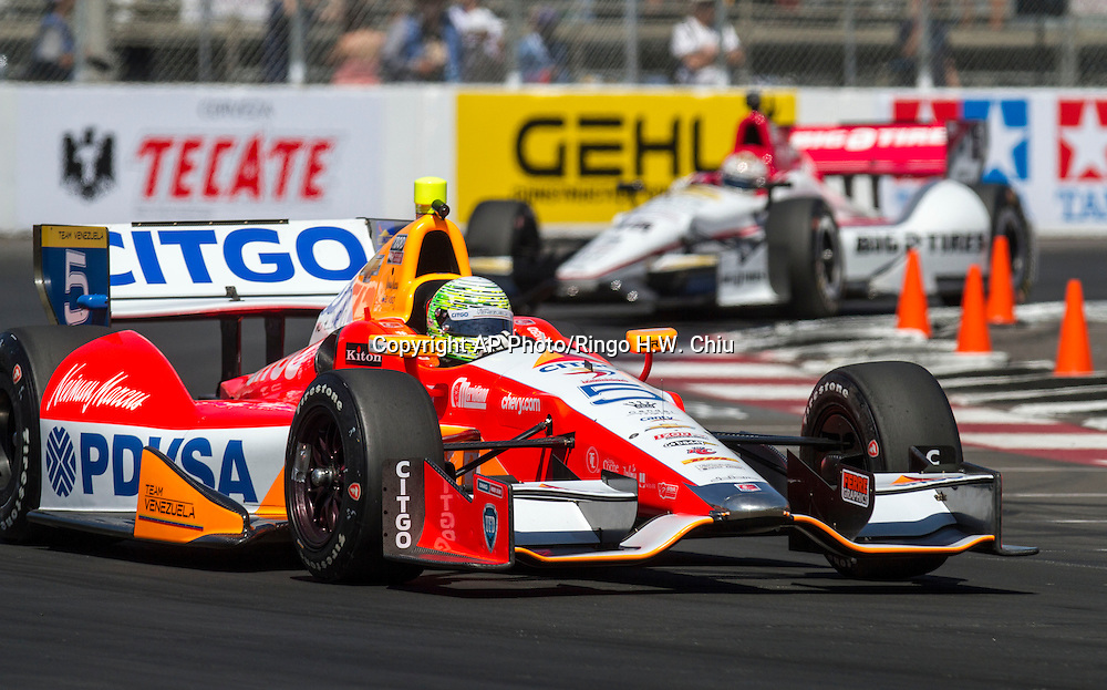 E.J. Viso races during the practice for the IndyCar Series 39th Annual Toyota Grand Prix of Long Beach auto race Saturday, April 20, 2013, in Long Beach, Calif.  (AP Photo/Ringo H.W. Chiu)..