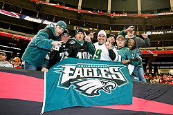 Philadelphia Eagles fans hold a flag before the NFL game between the Philadelphia Eagles and the Atlanta Falcons on December 7th 2009. At The Georgia Dome in Atlanta, Georgia. (Photo by Brian Garfinkel)