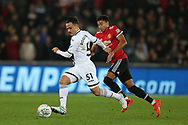 Roque Mesa of Swansea city (l) breaks away from Jesse Lingard of Manchester Utd.  EFL Carabao Cup 4th round match, Swansea city v Manchester Utd at the Liberty Stadium in Swansea, South Wales on Tuesday 24th October 2017.<br /> pic by  Andrew Orchard, Andrew Orchard sports photography.