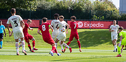 LIVERPOOL, ENGLAND - Wednesday, September 15, 2021: Liverpool's Max Woltman (L) scores the only goal of the game during the UEFA Youth League Group B Matchday 1 game between Liverpool FC Under19's and AC Milan Under 19's at the Liverpool Academy. Liverpool won 1-0. (Pic by David Rawcliffe/Propaganda)