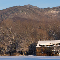 A farm in winter in Wonalancet, New Hampshire in the White Mountains.  Mount Wonalancet is in the distance.