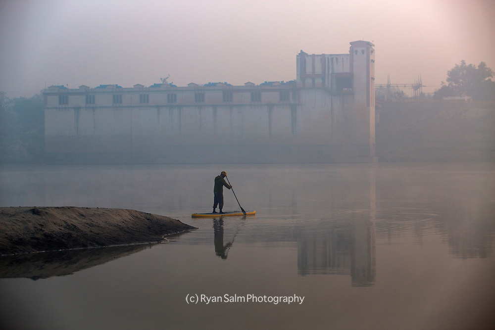 Jay Sanavage paddles through a calm morning mist after a tough nights sleep.