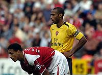 Photo: Olly Greenwood.<br />Charlton Athletic v Arsenal. The Barclays Premiership. 30/09/2006. Arsenal's Thierry Henry and Charlton's Talal El Karkouri