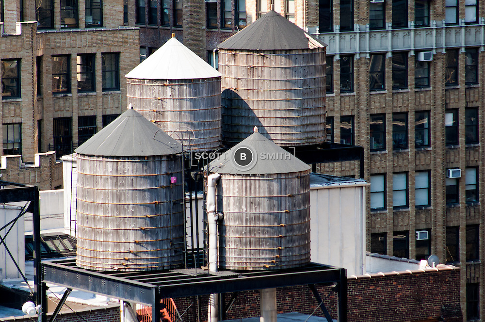 Rooftop water tanks in New York's garment district area; photo looking south toward site of twin towers in lower Manhattan.