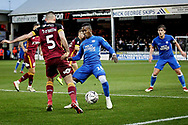 Peterborough United midfielder Siriki Dembele (10) and Bradford City defender Jim O'Brien (5)   during  the The FA Cup 2nd round match between Peterborough United and Bradford City at London Road, Peterborough, England on 1 December 2018.