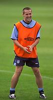 Photo. Jed Wee.<br /> England Training, England v Liechtenstein, European Championship Qualifier, The Cliff, Manchester. 09/09/2003.<br /> England's Michael Owen enjoys a light moment in training.