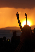 Hula dancers silhouetted against the sunset in Hawaii