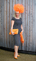 LIVERPOOL, ENGLAND - Friday, April 4, 2014: Linda Broad from Leeds wearing Piedeterre during Ladies' Day on Day Two of the Aintree Grand National Festival at Aintree Racecourse. (Pic by David Rawcliffe/Propaganda)