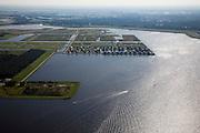 Nederland, Groningen, Oldambt, 08-09-2009; Hart van Blauwestad, het Oldambtmeer. Het meer dient ook als waterberging. Het project Blauwe Stad is bedoelt om de economisch achtergebleven regio van Noordoost Groningen een impuls te geven..Heart of Blauwestad (Blue City), the recreational lake. The Oldambt lake also serves as water storage. The Blue City project is meant to give a boost to the  economically backward region of northeast Groningen.luchtfoto (toeslag); aerial photo (additional fee required); .foto Siebe Swart / photo Siebe Swart
