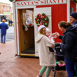 Gettysburg, PA / USA - December 7, 2019:  An elf at the Santa Shanty helps ready a child to visit Santa at The Annual Christmas Festival in the town square.