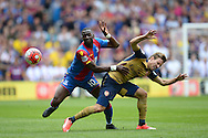 Yannick Bolasie of Crystal Palace tussles with Nacho Monreal of Arsenal as he competes for the ball. Barclays Premier league match, Crystal Palace v Arsenal at  Selhurst Park in London on Sunday 16th August 2015.<br /> pic by John Patrick Fletcher, Andrew Orchard sports photography.