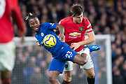 Michy Batshuayi of Chelsea and Harry Maguire of Manchester United challenge for the ball during the English Premier League match between Chelsea and Manchester United at Stamford Bridge, Monday, Feb. 17, 2020, in London, United Kingdom. Manchester United defeated Chelsea 2-0.(Salvio Calabrese/Image of Sport)