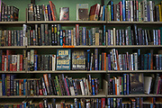 Books on library shelves at HMP Kingston. Portsmouth, United Kingdom. Kingston prison is a category C prison holding indeterminate sentenced prisoners.
