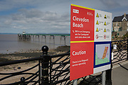 Safety warning sign on the beach at Clevedon, on 22nd April 2017, in North Somerset, England.