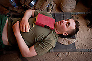 Lieutenant Kevin Gaughan sleeps with a copy of the collected works of Cormac McCarthy on his chest.
