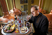 Brewmaster Joachim Rösch with all the food he eats in a typical day at Ganter Brewery in Freiburg im Breisgau, Germany. (From the book What I Eat: Around the World in 80 Diets.) The caloric value of his day's worth of food in March was 2700 kcals. He is 44 years of age; 6 feet, 2 inches tall; and 207 pounds. Joachim's job requires him to taste beer a number of times during the week, and unlike in wine tasting, he can't just taste then spit it out: ?Once you've got the bitter on the back of your tongue, you automatically get the swallow reflex, so down the chute you go,? he says. MODEL RELEASED.