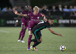 July 26, 2017 - Los Angeles, California, U.S - Oleksandr Zinchenko #35 of Manchester City battles for the ball with Lucas Vasquez #17 or Real Madrid during their International Champions Cup game at the Los Angeles Memorial Coliseum in Los Angeles, California on Wednesday July 26, 2017. Manchester City defeats Real Madrid, 4-1. (Credit Image: © Prensa Internacional via ZUMA Wire)