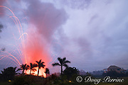 lava emanating from Kilauea Volcano, erupts from a fissure near a residence off Highway 132 between Pahoa and Kapoho in Puna District, Hawaii ( the Big Island ), Hawaiian Islands, U.S.A. ( Central Pacific Ocean ); explosive eruptions blast chunks of hot lava hundreds of feet into the air (the two lights near the bottom of the frame are landscape lighting)
