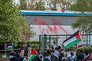 """Leicester, United Kingdom, May 19, 2021: Palestine Action activists are seen on the rooftop of the Elbit Systems manufacturer in Leicester. People gathered to support UK based Pro-Palestinian activists group """"Palestine Action"""" who seized control of the Leicester based factory of Elbit subsidiary UAV Tactical Systems on Wednesday, May 19, 2021. Activists say that """"the occupation is aiming to be as disruptive as possible; these activists are determined to prevent Elbit from resuming its business of bloodshed."""" (Photo by Vudi Xhymshiti/VXP)"""