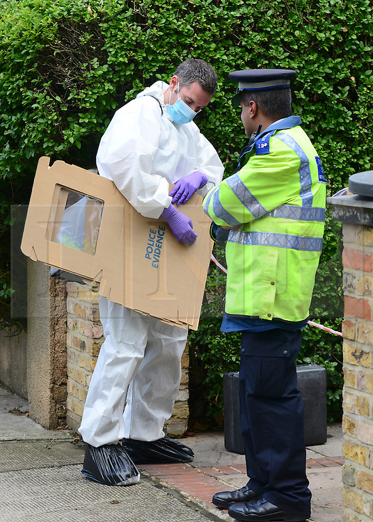 © Licensed to London News Pictures. 30/08/2012. London, UK A scenes of crimes officer at the scene. A street cleaner has suffered potentially life threatening after being stabbed when disturbing a burglary in Shepherds Bush in West London today 30 August 2012. Photo credit : Stephen Simpson/LNP