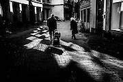 March 2015. Brussels. An aged couple walks on the streets.