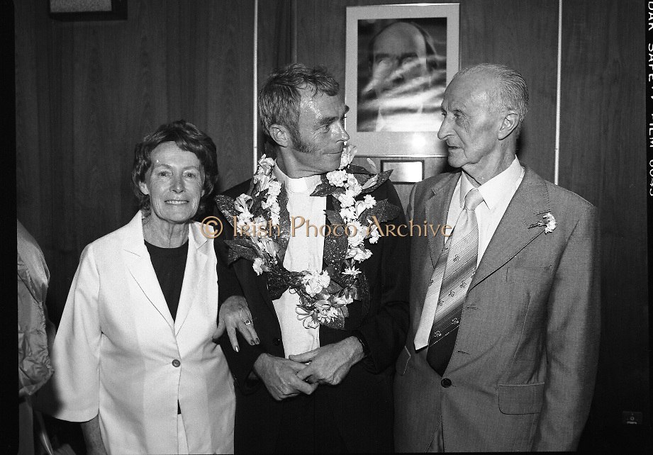 """Fr Niall O'Brien Returns from Captivity.1984..14.07.1984..07.14.1984..On 6 May 1983,Fr Niall O'Brien was arrested along with two other priests, Fr. Brian Gore, an Australian, Fr. Vicente Dangan, a Filipino and six lay workers - the so-called """"Negros Nine"""", for the murders of Mayor Pablo Sola of Kabankalan and four companions. The priests where held under house arrest for eight months but """"escaped"""" to prison in Bacolod City, the provincial capital, where they felt they would be safer.The case received widespread publicity in Ireland and Australia, the home of one of the co-accused priests, Fr. Brian Gore. When Ronald Reagan visited Ireland in 1984, he was asked on Irish TV how he could help the missionary priest's situation. A phone call the next day from the Reagan administration to Ferdinand Marcos resulted in Marcos offering a pardon to Fr. O'Brien and his co-accused..(Ref Wikipedia)...Image shows Fr Niall  O'Brien with  his Mother and Father in the V I P Lounge in Dublin Airport."""