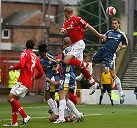 Photo: Richard Lane/Richard Lane Photography. Nottingham Forest v Cardiff City. Coca Cola Championship. 24/10/2008. Roger Johnson (R) heads clear as Nathan Tyson (C) challanges