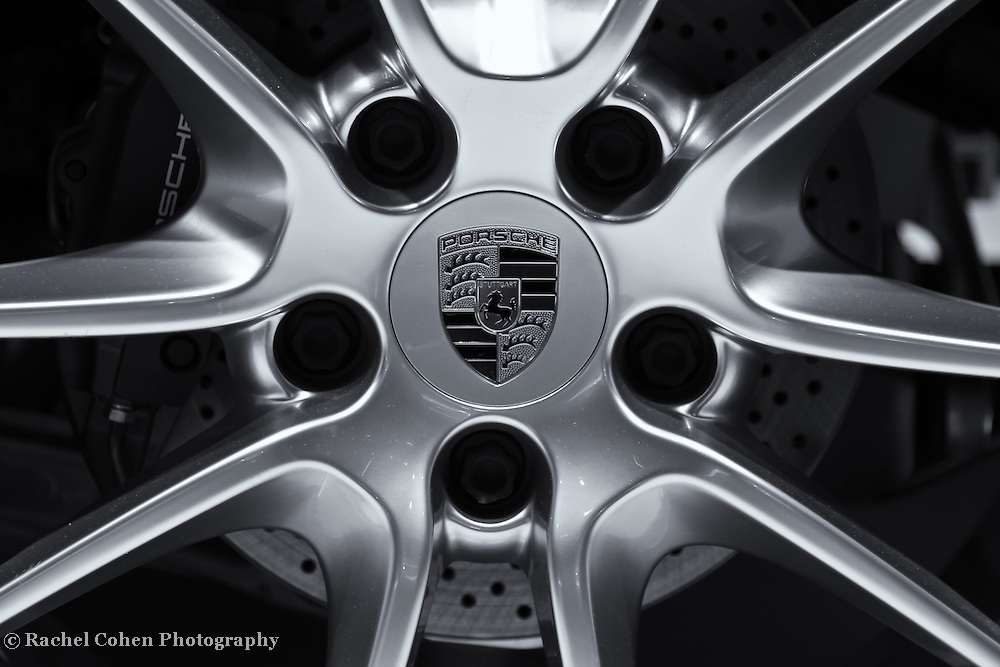 """""""Porsche Wheel""""- B&W<br /> <br /> An awesome black and white image of a Porsche wheel! Beautifully detailed!!<br /> <br /> Cars and their Details by Rachel Cohen"""