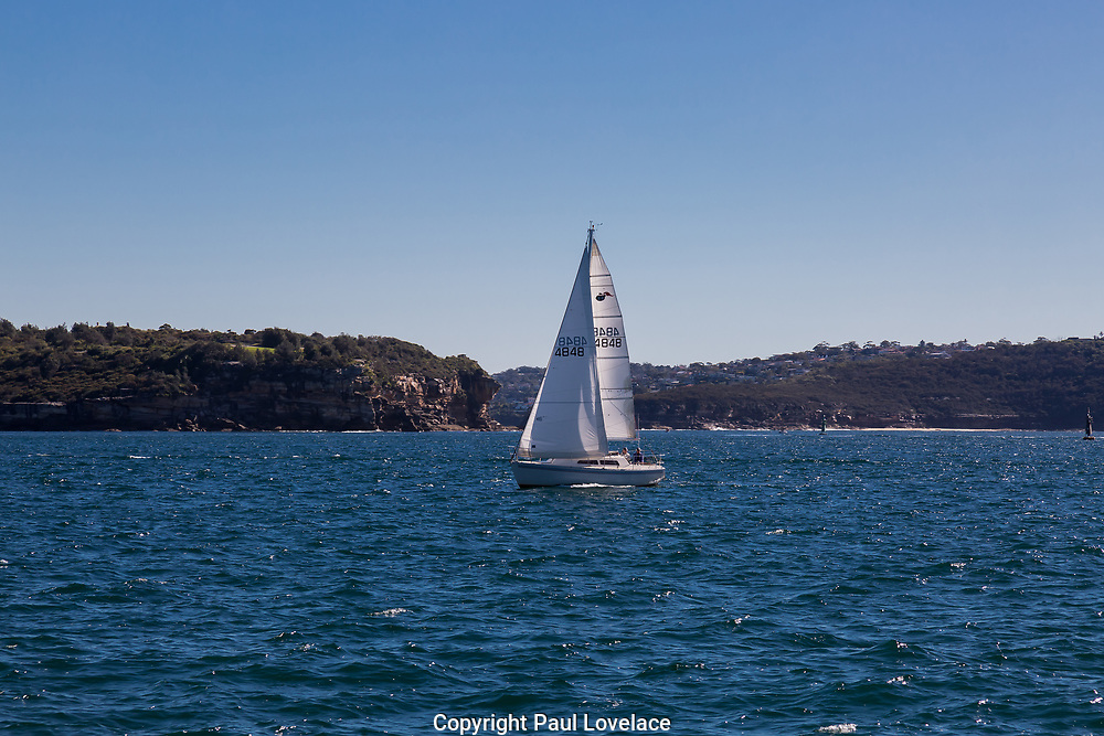 Views of the Sydney Heads, crossing from Watsons Bay to Manly on the fast ferry which takes approximately 15 minutes. A yacht crossing the heads.