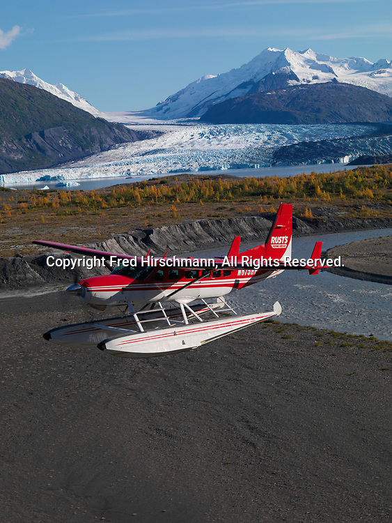 Rust's Flying Service Cessna 208 Caravan on floats flying past Colony Glacier, Lake George and Mount Muir, Chugach Mountains, Alaska.