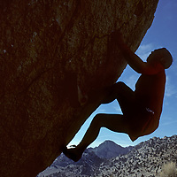 Doug Robinson climbs a boulder in the Buttermilk rocks, under the eastern slopes of California's Sierra Nevada.