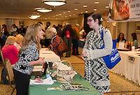 Kathy Robarge from Wilson Employment Services talks with Abbey Talbot during the Lakes Region Job Fair at the Margate Resort on Wednesday afternoon.  (Karen Bobotas/for the Laconia Daily Sun)