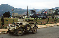 A British army Ferret armoured car watches over the loading/unloading supply run by a RAF CH-47 Chinook helicopter in Lebanon June 1983. Photograph by Terry Fincher