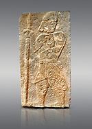 Pictures & images of the North Gate Hittite sculpture stele depicting a God with a spear. 8the century BC.  Karatepe Aslantas Open-Air Museum (Karatepe-Aslantaş Açık Hava Müzesi), Osmaniye Province, Turkey. Against grey background