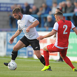 TELFORD COPYRIGHT MIKE SHERIDAN Steph Morley skips past Sam Austin during the National League North fixture between AFC Telford United and Kidderminster Harriers on Tuesday, August 6, 2019.<br /> <br /> Picture credit: Mike Sheridan<br /> <br /> MS201920-006