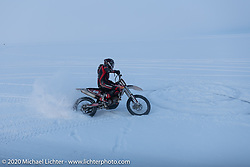 Baikal Mile Ice Speed Festival competitor in the snow beside the track. Maksimiha, Siberia, Russia. Saturday, February 29, 2020. Photography ©2020 Michael Lichter.