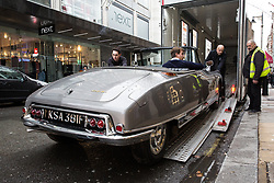 London, UK. 29th November, 2018. Auctioneers Bonhams move a 1966 Citroen DS-21 Decapotable in preparation for an auction of historic and high-performance racing and road cars. Highlights include a Le Mans class-winning Jaguar XJ220C driven by David Coulthard (£2,200,000-2,800,000), a Lister Jaguar Knobbly (£2,200,000-2,800,000) and a 1958 BMW 507 owned by its designer, as well as Ferraris, Aston Martins, Bentleys, Porsches and Jaguars. Bonhams, founded in 1793, is one of the world's largest and most renowned auctioneers of fine art and antiques, motor cars and jewellery.
