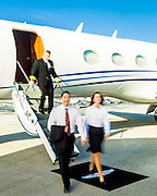 Executives exit a Gulfstream business jet at Opa-locka Executive Airport, near Miami.  Commissioned as advertising for Phillips 66 Aviation Fuels.<br /> <br /> Created by aviation photographer John Slemp of Aerographs Aviation Photography. Clients include Goodyear Aviation Tires, Phillips 66 Aviation Fuels, Smithsonian Air & Space magazine, and The Lindbergh Foundation.  Specialising in high end commercial aviation photography and the supply of aviation stock photography for advertising, corporate, and editorial use.