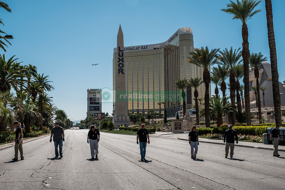 October 3, 2017 - Las Vegas, Nevada, U.S - Members of the FBI walk a stretch of South Las Vegas Boulevard, which is still closed off to the public, near the Mandalay Hotel and the site of Sunday's mass shooting which claimed the lives of 59 people and injured hundreds of others. (Credit Image: © Nick Otto via ZUMA Wire)
