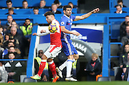 Diego Costa of Chelsea clashes with Alex Oxlade-Chamberlain of Arsenal. Premier league match, Chelsea v Arsenal at Stamford Bridge in London on Saturday 4th February 2017.<br /> pic by John Patrick Fletcher, Andrew Orchard sports photography.